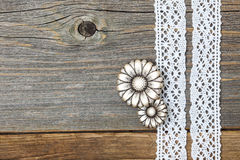 Vintage metal buttons flowers and lace ribbons Stock Images