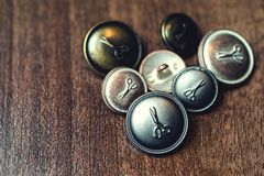 Vintage metal buttons with scissors on it Stock Images