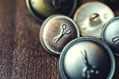 Vintage metal buttons with scissors on it Stock Photos