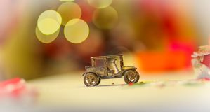Vintage metal car toy with christmas tree lights. Vintage metal car toy with beautiful bokeh with christmas tree lights in the background Stock Images