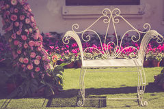 Vintage metal chair in the garden Stock Images