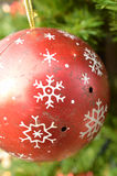 Vintage metal Christmas ornament red white snowflake pattern Stock Photography