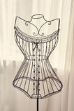 Vintage metal coat rack with wire dress form Stock Photos