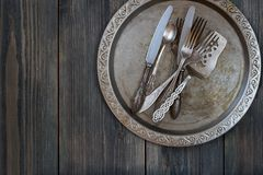 Vintage tableware on empty dark grey wooden background stock photography