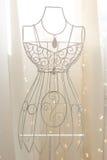Vintage metal hanger in dress shape Royalty Free Stock Photo
