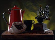 Vintage metal jug and old coffee grinder Royalty Free Stock Image