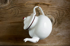 Vintage metal kettle. On rustic wooden background Stock Photography