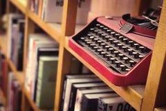 Vintage metal keyboard machine in the bookshelf Royalty Free Stock Photo