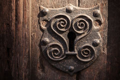 Vintage metal keyhole Stock Images