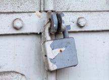 Vintage  metal lock on a gray door. Classic hanging lock. Stock Image