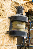 Vintage metal marine lantern attached to the wall Stock Image