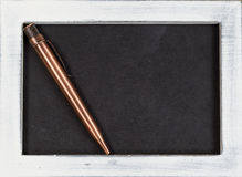 Vintage metal pen on used chalk board Stock Photo