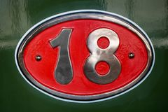 Vintage metal plate with number eighteen, detail of an old metal plate royalty free stock photos