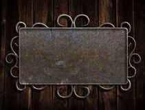 Vintage metal plate  on old oak door Stock Photography
