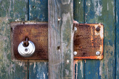 Vintage metal plate with padlock on old wooden door Royalty Free Stock Photos