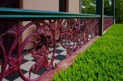 Vintage metal railing with leaf patterns Stock Photos
