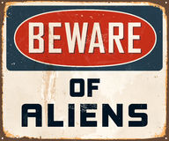 Vintage Metal Sign. Vintage Vector Metal Sign - Beware of Aliens - with a realistic used and rusty effect that can be easily removed for a clean, brand new sign Royalty Free Stock Images