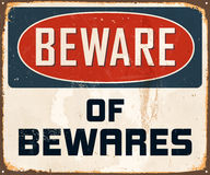 Vintage Metal Sign. Vintage Vector Metal Sign - Beware of Bewares - with a realistic used and rusty effect that can be easily removed for a clean, brand new sign Stock Photography