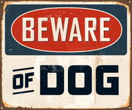 Vintage Metal Sign. Vintage Vector Metal Sign - Beware of Dog - with a realistic used and rusty effect that can be easily removed for a clean, brand new sign Stock Photos