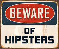 Vintage Metal Sign. Vintage Vector Metal Sign - Beware of hipsters - with a realistic used and rusty effect that can be easily removed for a clean, brand new Royalty Free Stock Images