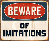 Vintage Metal Sign. Vintage Vector Metal Sign - Beware of imitations - with a realistic used and rusty effect that can be easily removed for a clean, brand new Stock Photos