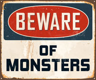 Vintage Metal Sign. Vintage Vector Metal Sign - Beware of Monsters - with a realistic used and rusty effect that can be easily removed for a clean, brand new Stock Photos
