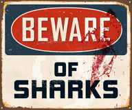 Vintage Metal Sign. Vintage Vector Metal Sign - Beware of Sharks - with a realistic used and rusty effect that can be easily removed for a clean, brand new sign Stock Image
