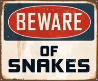 Vintage Metal Sign. Vintage Vector Metal Sign - Beware of Snakes - with a realistic used and rusty effect that can be easily removed for a clean, brand new sign Royalty Free Stock Photos