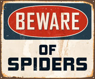 Vintage Metal Sign. Vintage Vector Metal Sign - Beware of Spiders - with a realistic used and rusty effect that can be easily removed for a clean, brand new sign Stock Images