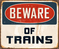 Vintage Metal Sign. Vintage Vector Metal Sign - Beware of Trains - with a realistic used and rusty effect that can be easily removed for a clean, brand new sign Royalty Free Stock Photo