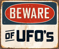 Vintage Metal Sign. Vintage Vector Metal Sign - Beware of UFO`s - with a realistic used and rusty effect that can be easily removed for a clean, brand new sign Stock Images