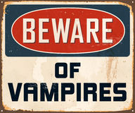 Vintage Metal Sign. Vintage Vector Metal Sign - Beware of Vampires - with a realistic used and rusty effect that can be easily removed for a clean, brand new Royalty Free Stock Photo