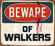 Vintage Metal Sign. Vintage Vector Metal Sign - Beware of Walkers - with a realistic used and rusty effect that can be easily removed for a clean, brand new sign Stock Photo