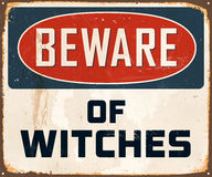 Vintage Metal Sign. Vintage Vector Metal Sign - Beware of Witches - with a realistic used and rusty effect that can be easily removed for a clean, brand new sign Stock Photo