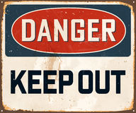 Vintage Metal Sign. Vintage Vector Metal Sign - Danger Keep Out - with a realistic used and rusty effect that can be easily removed for a clean, brand new sign Stock Photos