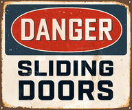 Vintage Metal Sign. Vintage Vector Metal Sign - Danger Sliding Doors - with a realistic used and rusty effect that can be easily removed for a clean, brand new Stock Photography