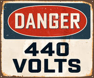 Vintage Metal Sign. Vintage Vector Metal Sign - Danger 440 Volts - with a realistic used and rusty effect that can be easily removed for a clean, brand new sign Stock Photography