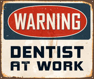 Vintage Metal Sign. Vintage Vector Metal Sign - Warning Dentist at Work - with a realistic used and rusty effect that can be easily removed for a clean, brand Royalty Free Stock Images