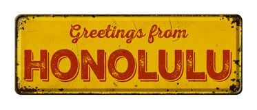 Vintage metal sign on a white background - Greetings from Honolu. Lu Royalty Free Stock Photo