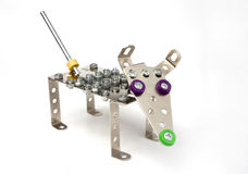 Vintage metal toy - dog. On white Stock Photos