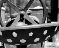 Vintage Metal Tractor Seat and Steering Wheel. Black and white image of vintage Farmall metal tractor seat and steering wheel Royalty Free Stock Photos