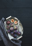 Vintage metal tray of fresh figs on dark background, top view, selective focus. stock photos