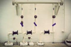 Vintage Metal water pipes Stock Images
