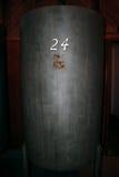 Vintage Metal Wine Barrel. A vintage metal wine barrel in winery in Sonoma CA Stock Photos