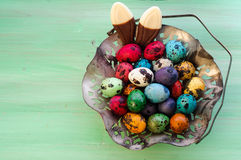 Vintage Metall Easter Eggs Basket and Chocolade Bunny Ears Royalty Free Stock Images