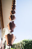 Vintage metallic bells used for rain waters way-out in zen garde Royalty Free Stock Photos