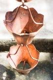Vintage metallic bells used for rain waters way-out in zen garde Stock Photo