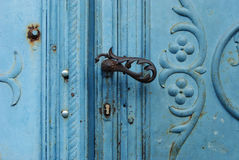 Old metallic door. Vintage metallic door with wrought iron handle Royalty Free Stock Photos
