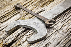 Vintage metallic spanners on old wooden table Royalty Free Stock Photography