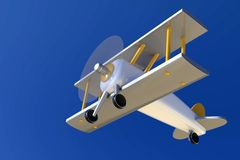 Vintage metallic toy airplane flying on blue sky. Retro style metallic biplane toy, represented as flying on a blue sky background. Silver wings and fuselage royalty free illustration